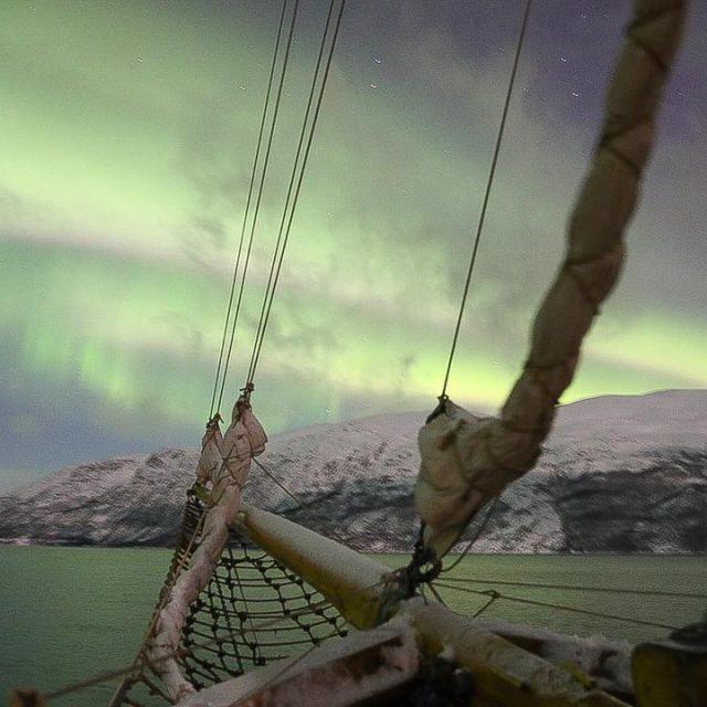 Troms  Norway Caando as auroras boreais num veleiro dehellip